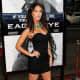 Megan Fox in a short black dress and high heels