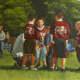 Oil Painting of my grandson's Flag Football Team huddle.