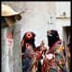 Two Yemeni females in Sana'a city while wearing the Sana'ani Sitarah with its Mughmug and Lithmah