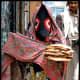 A Yemeni woman wearing the Sana'ani Sitarah in a local market of Sana'a city