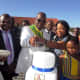 Vhavenda King, Toni Mphephu Ramabulana helped by the Queen Hulisani Ramabulana to cut the cake of his birthday, while Thovhele Kennedy Tshivhase (left) looked on and traditional leaders and community at large ululated.