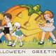 Free vintage Halloween card: children and large carved pumpkin