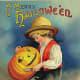 Vintage Halloween card: little boy with carved Jack-o-lantern