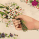Vintage hand with forget-me-nots Valentine flowers
