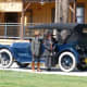Three-month long centennial celebration included vintage cars and folks dressed in period costumes.