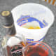 Get out your pail and add the lemonade and orange juice. Measure out your alcohol of choice