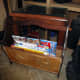 Test of the modified magazine rack with magazines before wood staining newly fitted pieces to match the original wood.