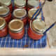 Gently move each jar to your canner, and fill to 2 inches above your jars.