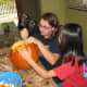 Carving Pumpkins. Team work in pumpkin carving makes it more fun.  Have a couple of pumpkins for kids to work on together.  Let them make designs on paper before marking the pumpkin to carve.
