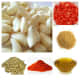 Ingredients: clockwise—garlic, tomatoes, mustard seeds, mustard oil, chilli powder, coriander seeds