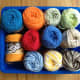 Select yarn colors for each planet. Use the planet color chart from the mini clay project above.