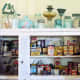A shelf or cabinet with glass pane is the perfect place to display vintage containers, cans, tupperware and more!