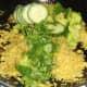 Cucumber and coriander/cilantro added to duck leg biryani