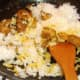Cooled rice is added to spiced duck meat