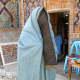 Woman in Uzbekistan wearing a paranja