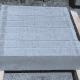 b. Rectangular cement blocks on wood supports.