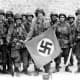 101st Airborne troops posing with a captured Nazi vehicle air identification sign two days after landing in Normandy June 8,1944.