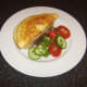 Poached chicken omelette is laid on toast