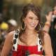 Hilary Duff wearing large textured gold hoop earrings