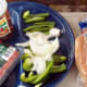 Chili Hot Dogs are yummy with organic hot dog weenies, organic chili beans, and fresh-cut green pepper and onions.