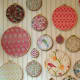 [http://lindsaychristensendesign.com - no longer active] Embroidery hoops can double as wall décor and bulletin boards.