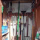 Garden tools hanging up in the small extension shed.