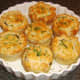 Mini haggis and clapshot puff pastry pies served garnished with chives