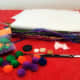 Use supplies you may already have around the house that you might normally throw away, like tissue paper and old buttons.