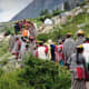 The villagers going to receive the flower gatherers