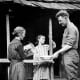 Sergeant Alvin C. York's mother is pouring water into the basin while his younger sister looks on. York turned down many lucrative offers, including one worth $30,000 to appear in vaudeville, to return to the life he had known before the war.