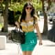 Kim Kardashian wearing sexy high heels and a skirt