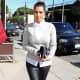 Kim Kardashian in leather pants and high heels