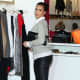 Kim Kardashian in leather pants and high heels side view