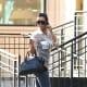 Kim Kardashian in tight jeans and high heels
