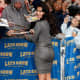 Kim Kardashian in a form fitting dress and towering high heels appearing on the Late Show