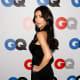 Kim Kardashian wearing a pretty dress and high heels