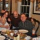 Jeff, Mark, Mom and me share a memory of a special dinner.