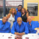 The Intruders sign autographs as they take a photo with my twin sister Paulette and I.