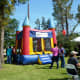 One of several inflatable bounce houses for children at Creekfest