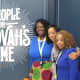 """Starting from the left is Brittany and Wanisha. On the right is Chantal, Jaleesa and Claudette, in front of this powerful message entitled, """"A People for Jehovah's Name."""""""