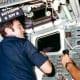 Dick Scobee with Commander Crippen on Challenger's flight deck.