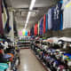Inside the shop with rows of branded goods