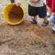 We poured buckets of water over the clay & hay.  (You can use a hose for the water if you want less work.)
