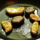Photo of sautéing the fingerling potatoes after being briefly microwaved and smashed by hand to flatten them out.