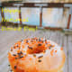 A glazed donut with sprinkles and a hot coffee—the perfect pairing!