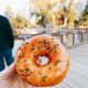 A sugar-glaze donut with sprinkles on top