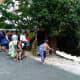 Tourists near huts where locals are braiding hair