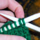 Insert working needle into the two new needles as if to knit.