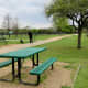 Picnic tables outside of fenced areas in the Millie Bush Bark Park