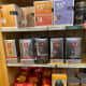 Assorted coffee grounds, coffee capsules, and coffee beans from Italy and France.